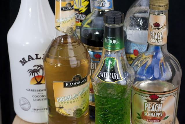 alien urine sample cocktail, coconut rum, malibu rum, melon liqueur, banana liqueur, peach schnapps, sweet & sour juice, soda water, blue curacao