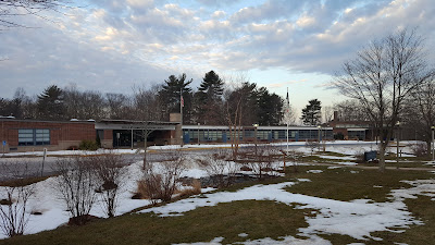 snow gradually disappears from the Parmenter School