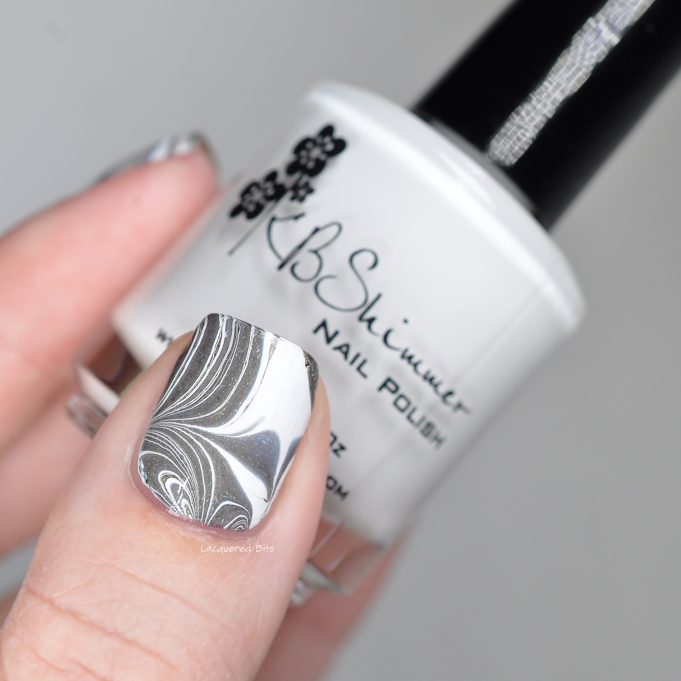 White and Black Water Marble Nails