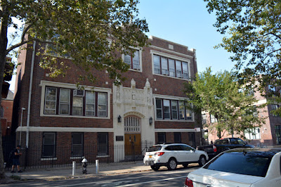 Three story red brick parochial school building on church property