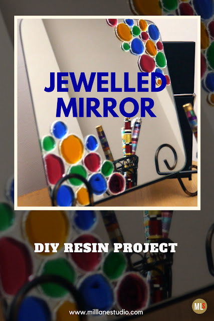 Square mirror decorated with jewel-coloured resin circles