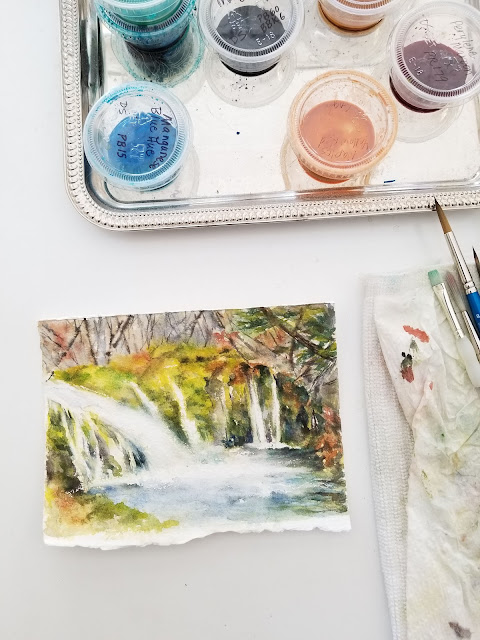 Watercolor in progress; waterfall.