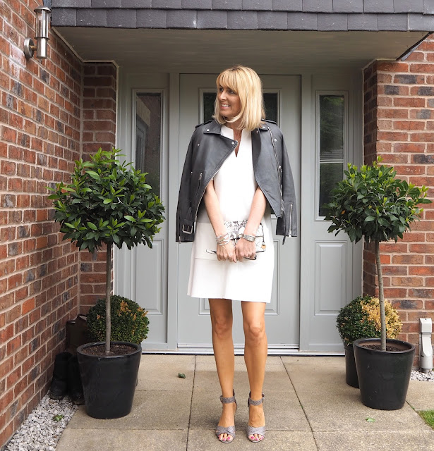white shift dress and grey biker jacket