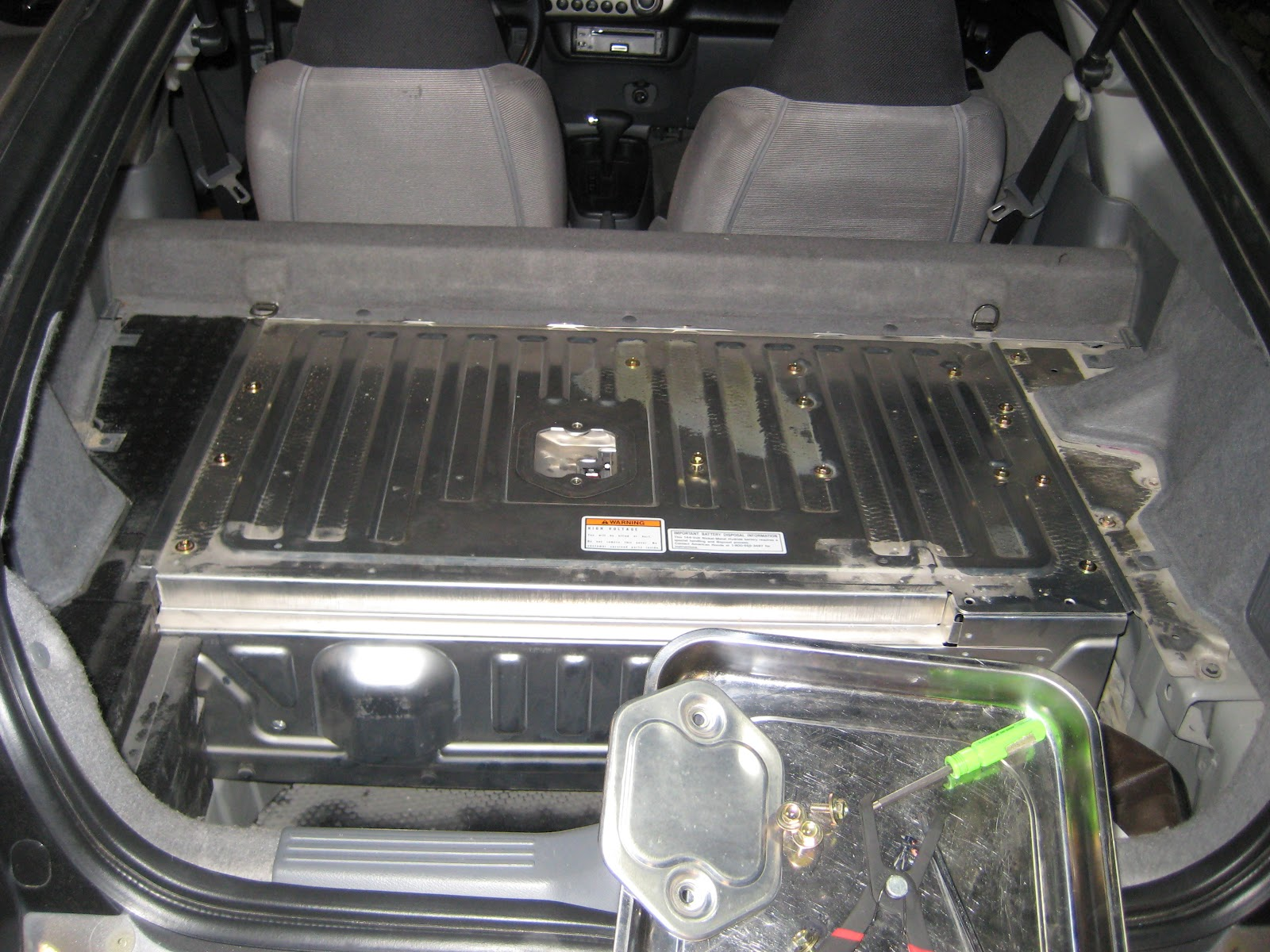 Hv Battery Is Found In The Back Trunk There A Center Plate That Opens For Disable Switch