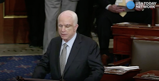 McCain, battling cancer, returns to Senate and casts critical health care vote