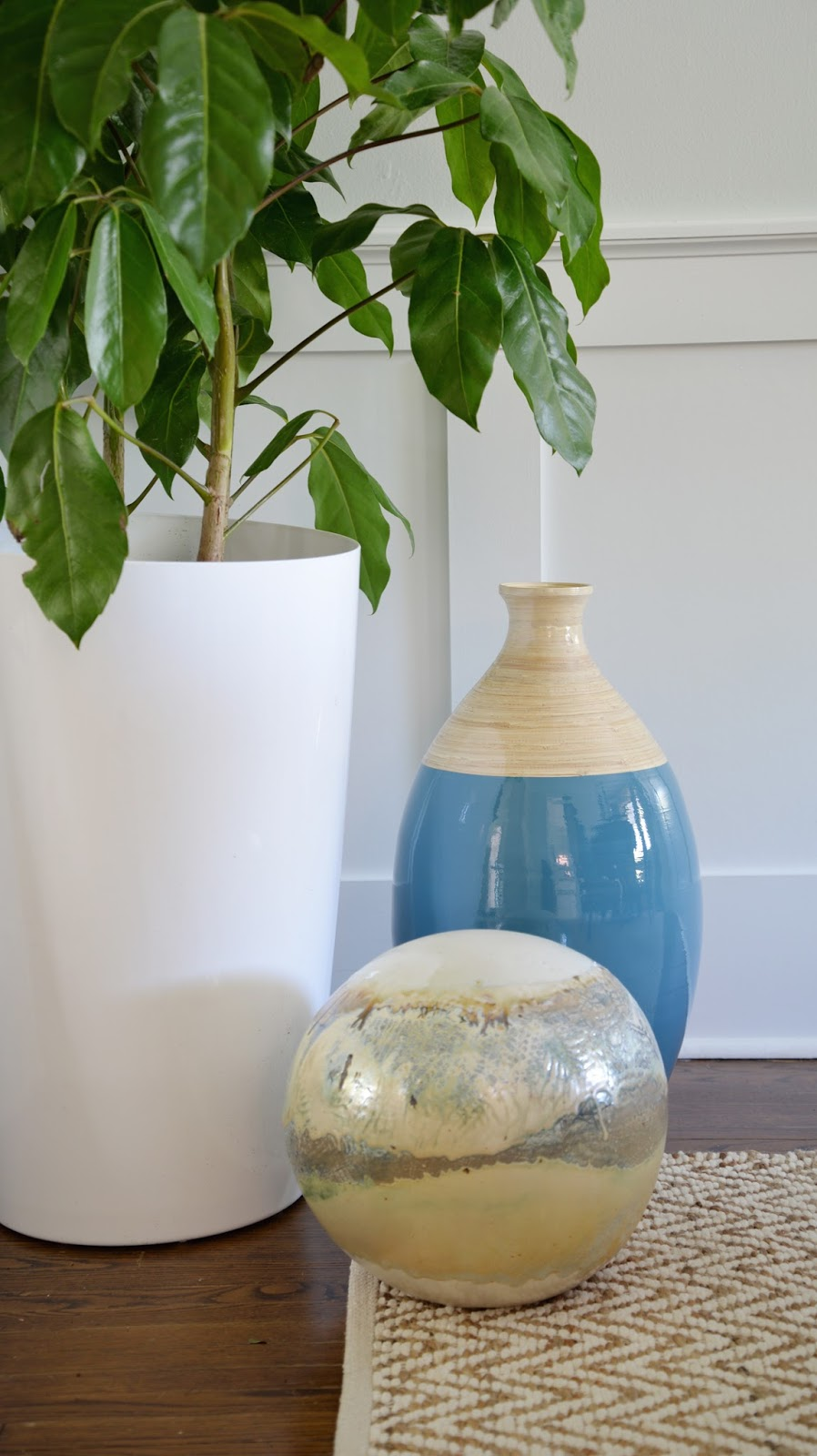 Rambling Renovators   tropical dining room, jute rug, ceramic ball, tropical plant