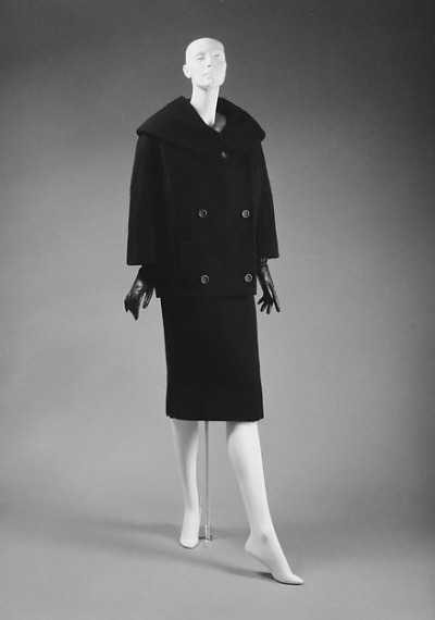 "Black suit designed by Christian Dior for his last collection for Fall/Winter 1957-1958 ""Spindle"" line"