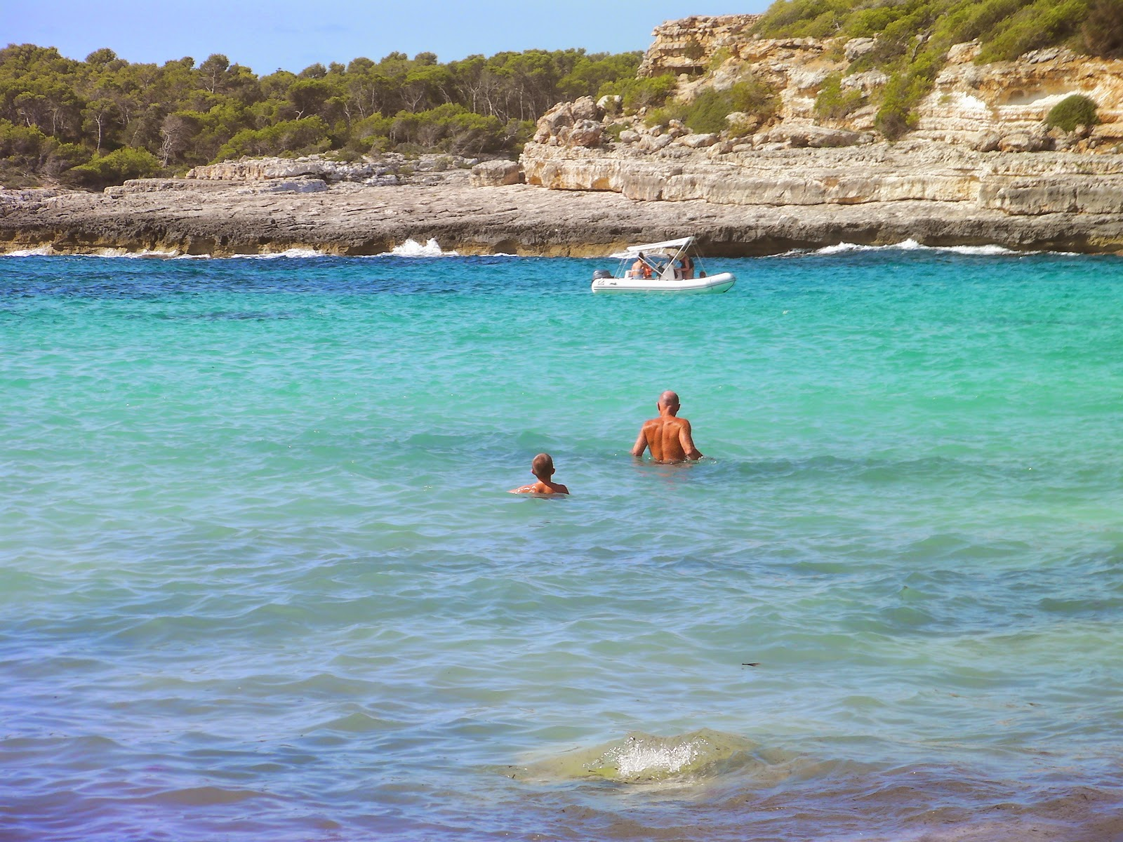 father and son in mediterranean sea majorca cala mondrago