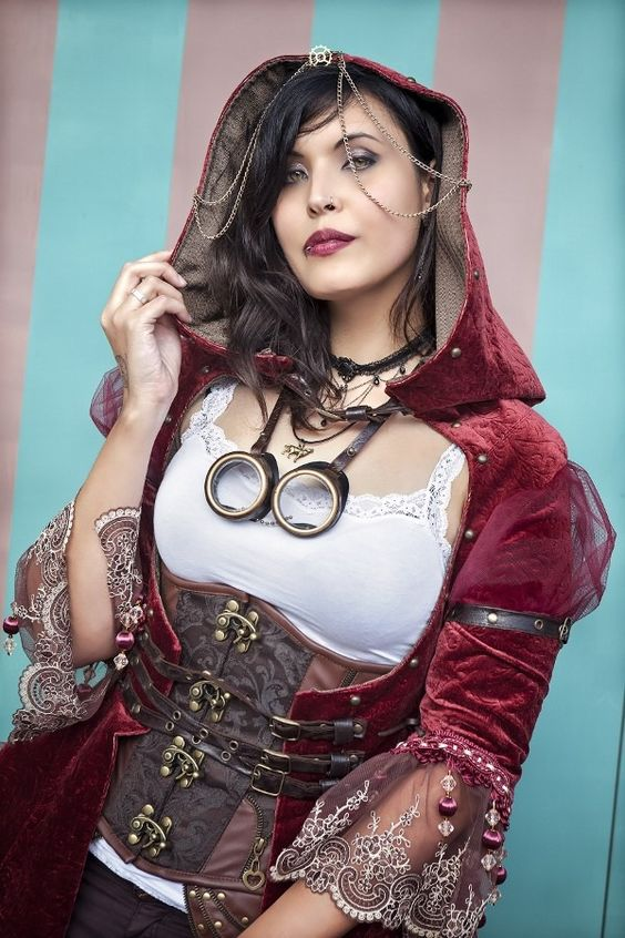 Steampunk Little Red Riding Hood cosplay. Woman's steampunk costume: corset, red velvet hooded jacket, goggles, choker, nose ring and lip ring. Alternative Little Red Riding Hood.