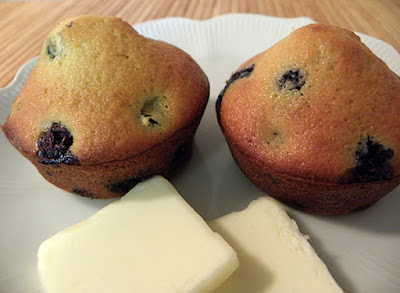 Two Blueberry Muffins with Two Pats of Butter