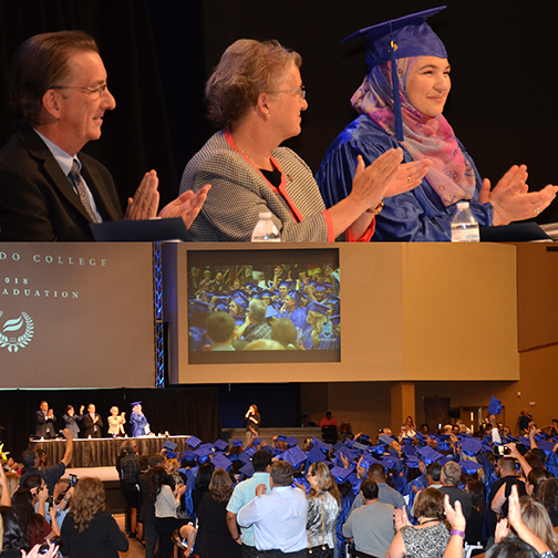images from graduation, featuring stage party and graduates being honored.
