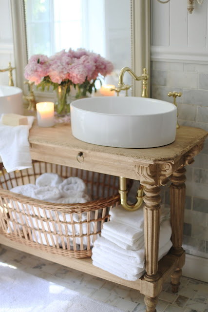 white towels in basket in bathroom