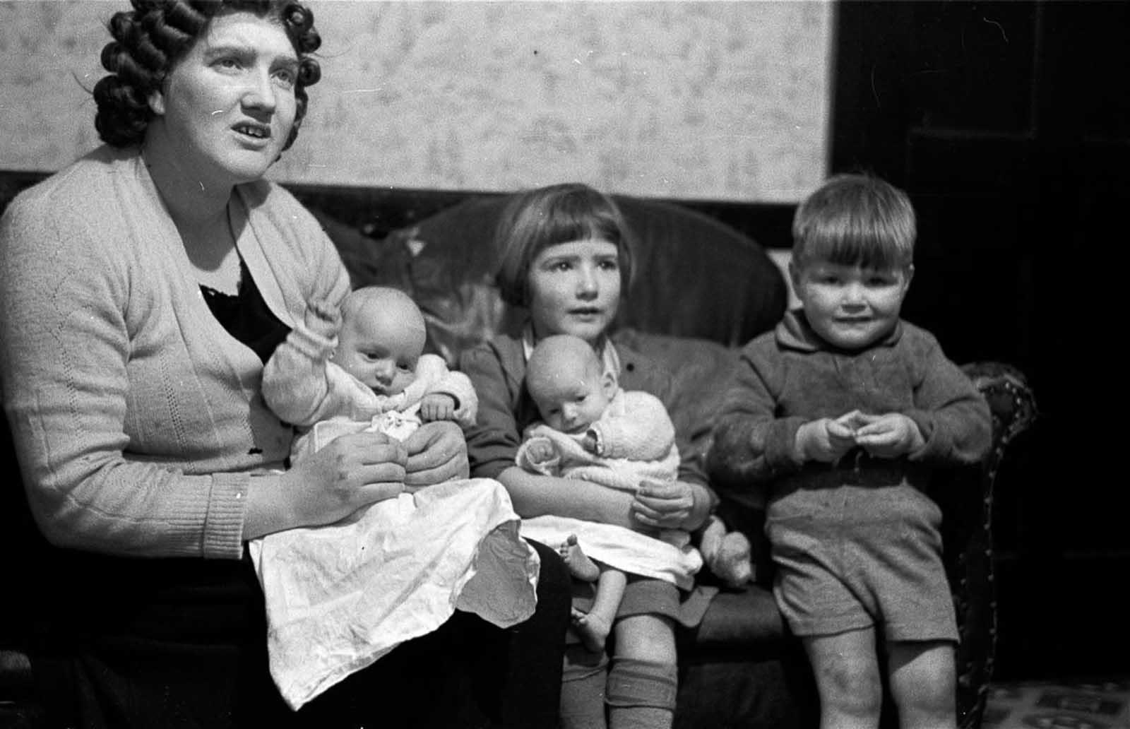 27-year-old Briton Ivy Bourne, mother of triplets and twins. Her mother had a total of 22 children, including one set of triplets and four sets of twins, 1953.