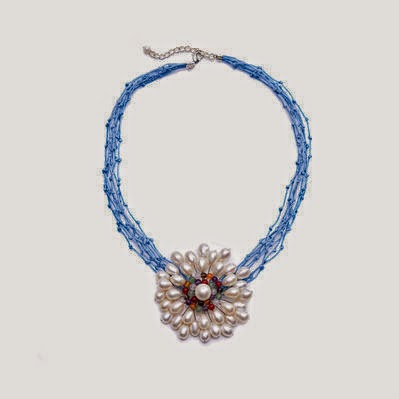 http://shop.unicefusa.org/cultured-pearl-flower-necklace/1UGG1507.html