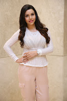 Kyra Dutt in Tight White Top Trousers at Paisa Vasool audio success meet ~  Exclusive Celebrities Galleries 012.JPG
