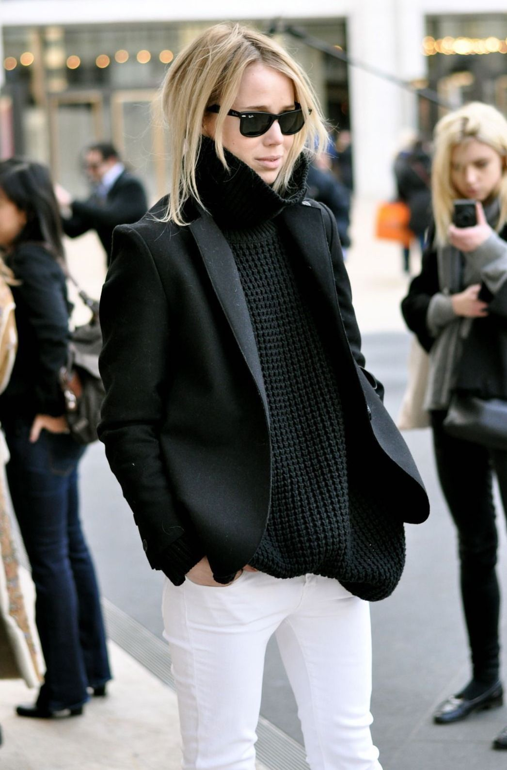 Elin Kling Street Style — Winter Outfit Idea — Black Turtleneck Sweater, Tuxedo Blazer Jacket, White Jeans, and Ray-Ban Wayfarer Sunglasses