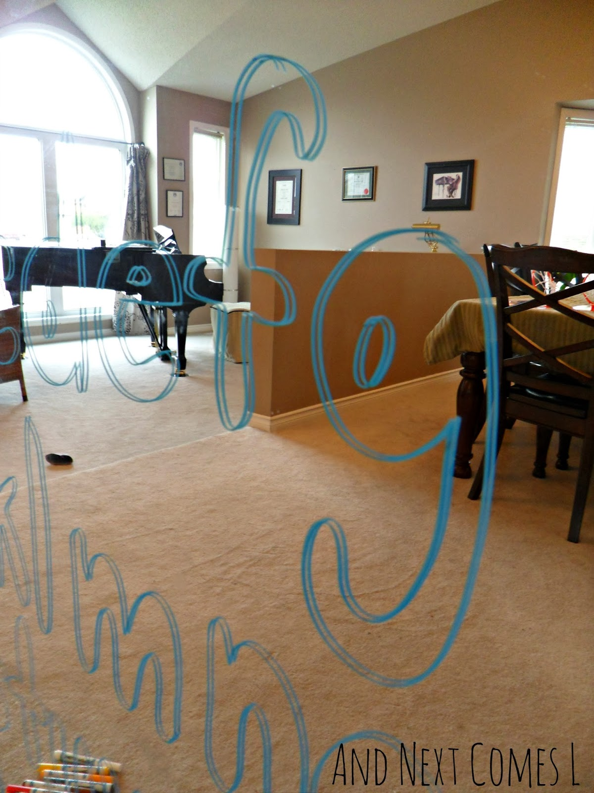tracing letters on mirrors with window markers  light
