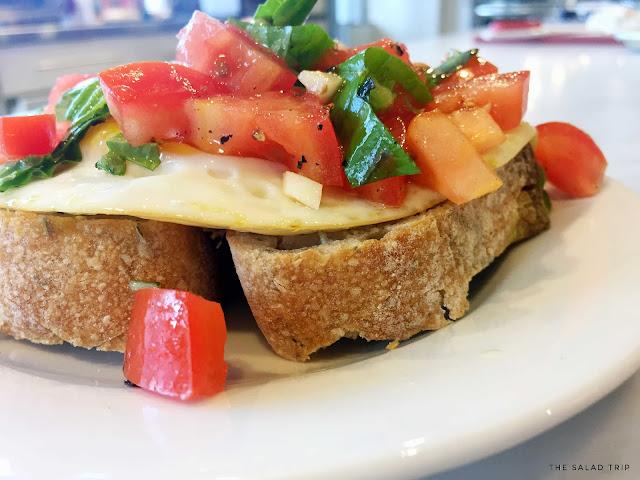 Bruschetta Breakfast on top of a white plate in a kitchen