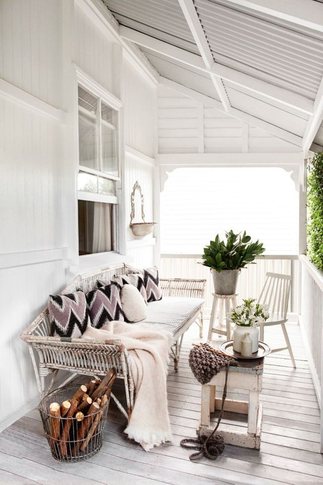 Bohemian Chic Decor in a Vintage Cottage With White porch and vintage furnishings. #porch #whitedecor #cottage #rusticdecor