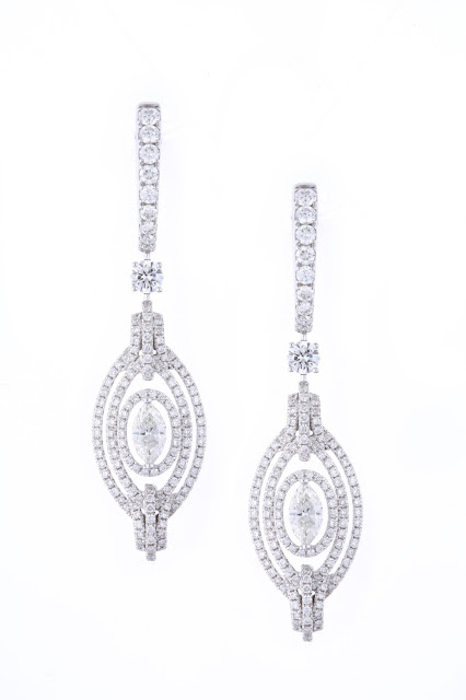 Entice delicate pear shaped diamond earrings