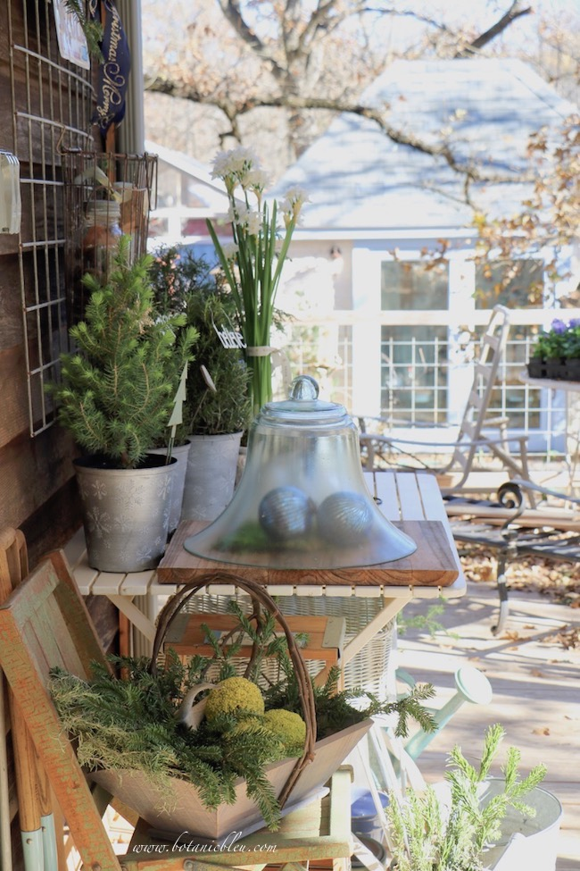 Christmas potting bench on a back porch is a great place to work on Christmas greenery
