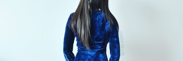 A sexy holiday party outfit featuring SheIn's dark blue velvet deep-V neckline plunging lace-up bodycon dress, worn with black suede over-the-knee wedge boots.