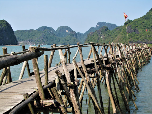 wooden bridge temple cat ba halong bay vietnam