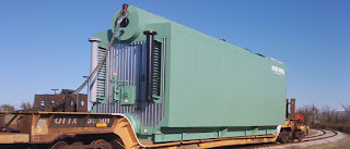 Palletized industrial boiler on rail car for shipment