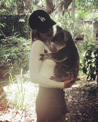 Lucy Hale hugging koala in Australia