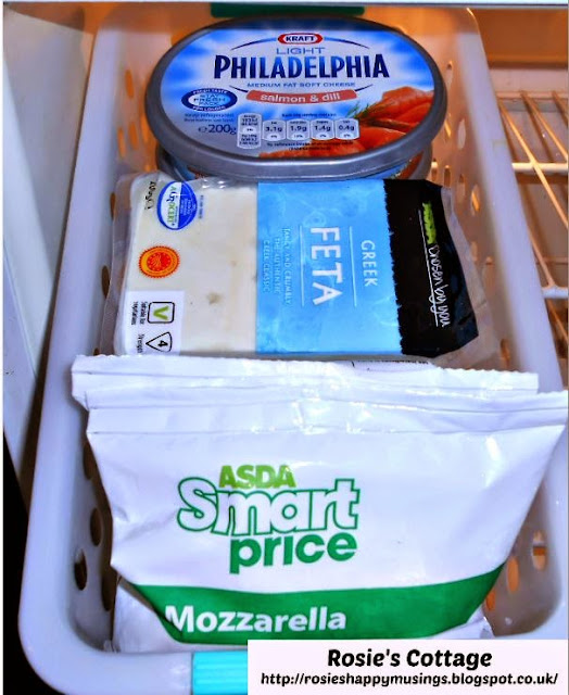 Refrigerator organization using bins - cheeses.
