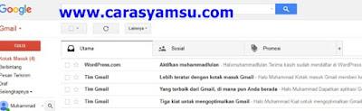 Buka email Anda