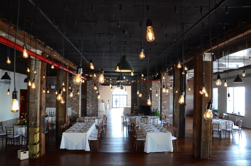 Suspended Individual Pendant Lamps With Style Edison Bulbs Over Dance Floor At The Liberty Warehouse Along String Lights
