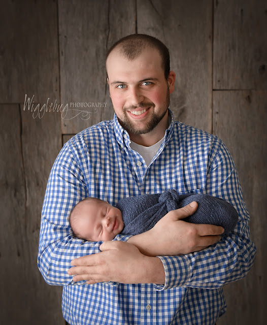 Newborn Baby Boy and Daddy in the DeKalb IL photography studio of Wigglebug Photography