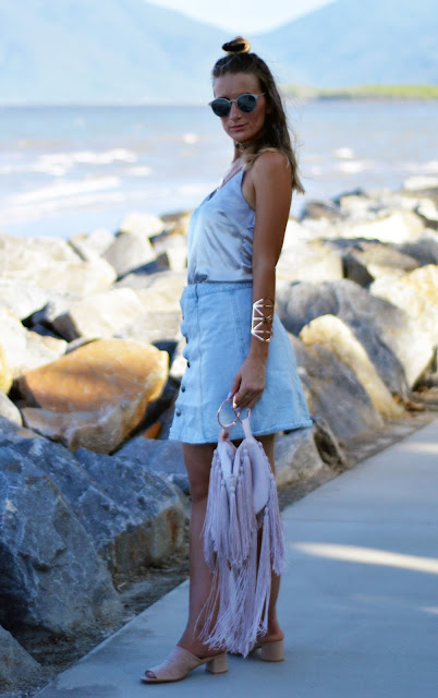 button up denim skirt silk cami and fringe clutch