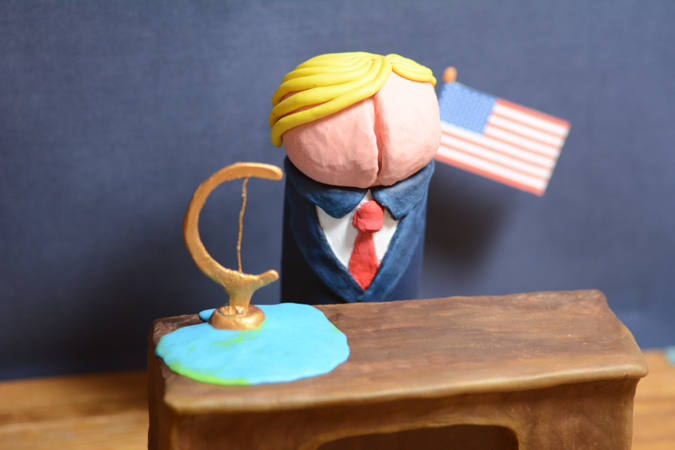 Donald Trump as a clay figurine with a melted globe on his desk