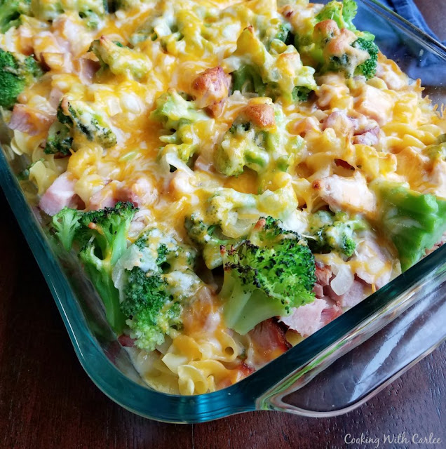casserole dish filled with pasta, broccoli, cheese and ham fresh from oven