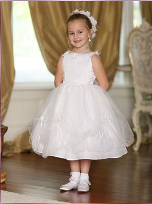 6bc051821fa This heavenly dress has a satin bodice and double layer tulle skirt with  curly wire edging. It comes with flower decoration on the neckline and on  the swag ...