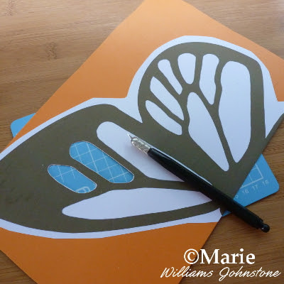 Using a craft knife and cutting mat