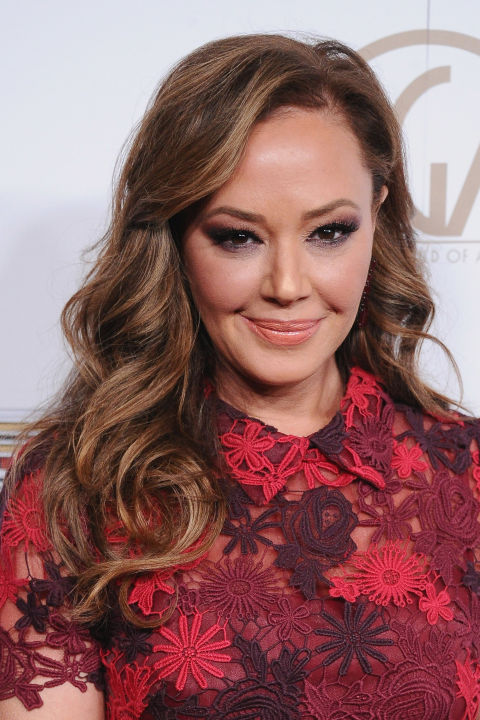 A classic combo: medium-brown hair and warm, not-quite-blonde highlights. No wonder it's a favorite of Leah Remini and so many other salon-goers!