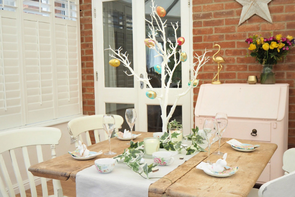 How to decorate a small dining room table and chairs for easter using decorative twig tree, plastic marble effect eggs, artificial ivy and mini eggs in teacups