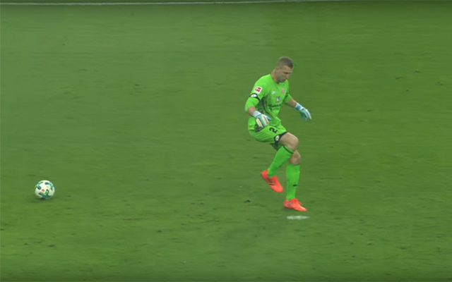 Mainz goalkeeper Robin Zentner kicks thin air after receiving a back pass