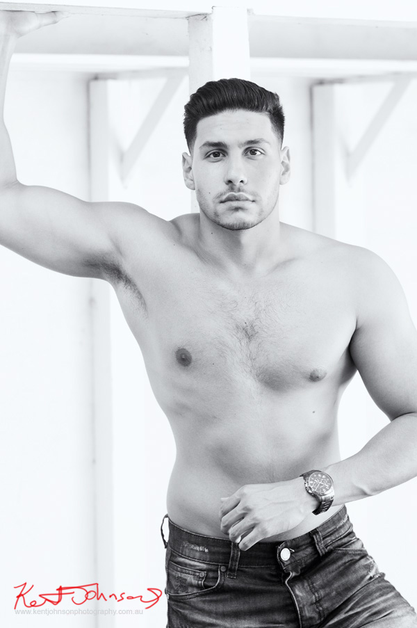 Gaz, a strong, black and white mid shot, shit off, male modelling portfolio shot on Location in Sydney Australia by Kent Johnson.