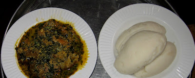 Egusi soup served with pounded yam