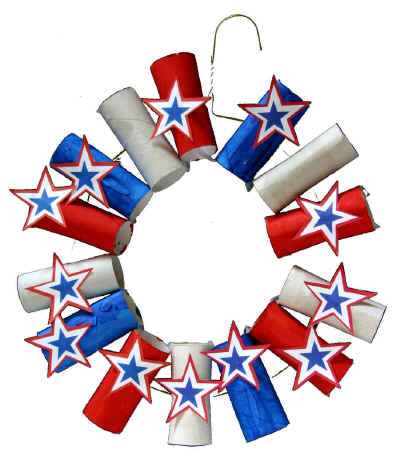 This DIY 4th of July wreath made with a hanger, painted toilet paper holders and star cutouts is festive.
