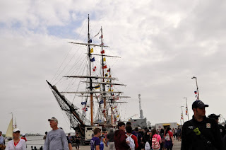 tall ship at dock with flags
