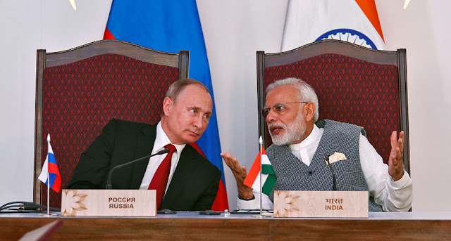 Image Attribute: India's Prime Minister Narendra Modi (R) speaks with Russian President Vladimir Putin during exchange of agreements event after India-Russia Annual Summit in Benaulim, in the western state of Goa, India, October 15, 2016. REUTERS/Danish Siddiqui