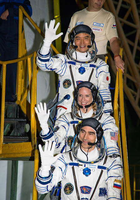 Expedition 48-49 crewmembers Japanese astronaut Takuya Onishi of the Japan Aerospace Exploration Agency (JAXA), top, Kate Rubins of NASA, middle, and Russian cosmonaut Anatoly Ivanishin of Roscosmos wave farewell before boarding their Soyuz MS-01 spacecraft for launch Thursday, July 7, 2016, Baikonur, Kazakhstan. The trio will launch from the Baikonur Cosmodrome in Kazakhstan the morning of July 7, Kazakh time (July 6 Eastern time.) All three will spend approximately four months on the orbital complex, returning to Earth in October. Photo Credit: (NASA/Bill Ingalls)