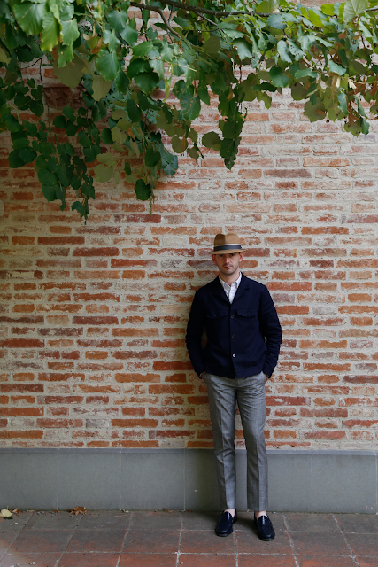 Paul Stood in Front of Red Brick Wall Under Shade of Tree