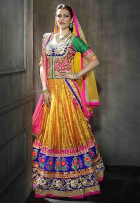 Beautiful Indian Model Girl In Dark Yellow Art Silk Lehenga Choli With Dupatta.