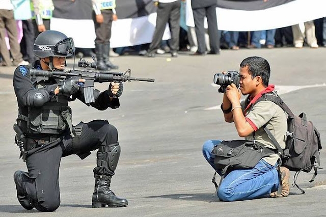 Crazy Photographers with soldier